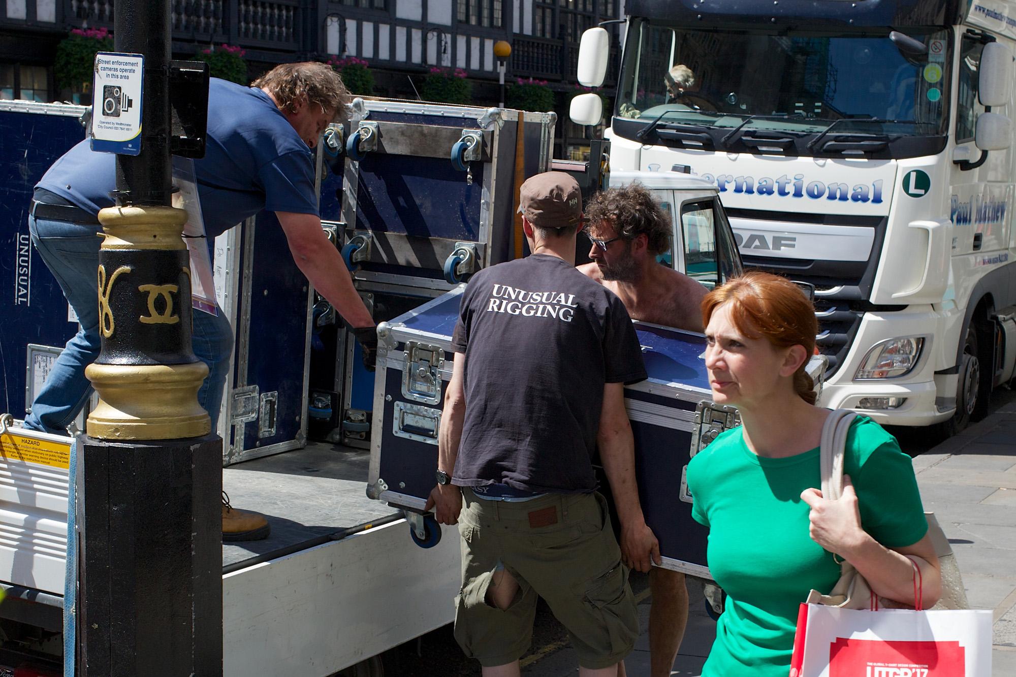 men unloading theatre props